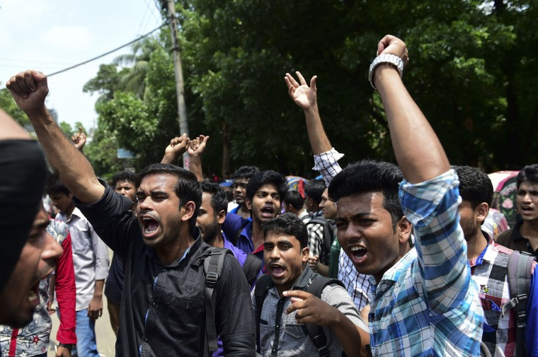 Bangladeshi students block the road and stage a protest following the murder of a law student, hacked to death by four assailants the night before, in Dhaka on April 7, 2016. A Bangladeshi law student who posted against Islamism on his Facebook page has been murdered, police said on April 7, the latest in a series of killings of secular activists and bloggers in the country. (Munir uz Zaman/AFP/Getty Images)