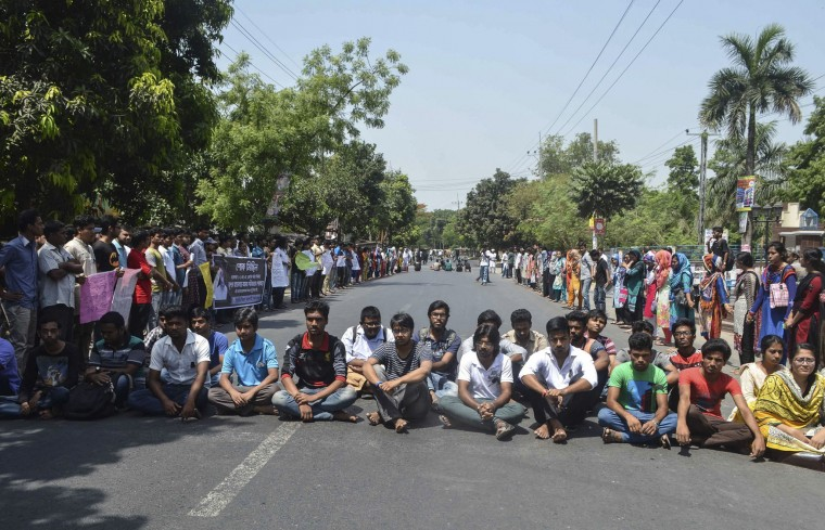 Bangladeshi students protest in Rajshahi on April 24, 2016 a day after unidentified attackers hacked to death a university professor. Bangladesh police arrested an Islamist student on April 24 over the hacking to death of a professor one day earlier, the latest such killing claimed by the Islamic State group. (AFP/Getty Images)