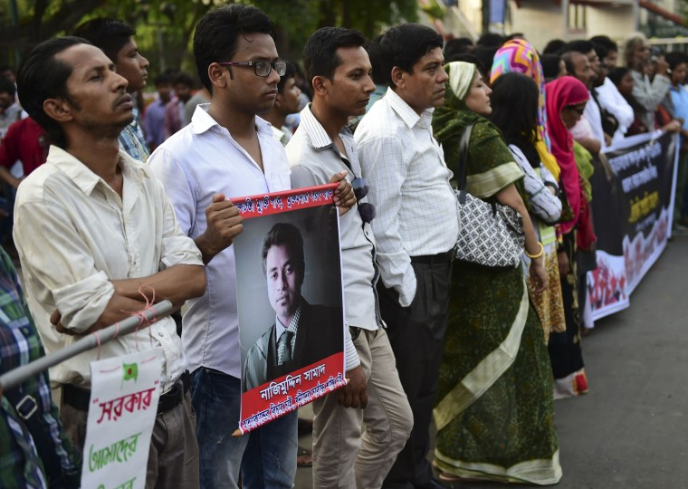 Bangladeshi secular activists and university students take part in a protest in Dhaka on April 8, 2016, following the murder a 26-year-old law student. Bangladesh vowed April 8 to catch the killers of a student murdered this week after criticizing Islamists on social media, as hundreds of secular activists held a protest to demand action. (Munir uz Zaman/AFP/Getty Images)
