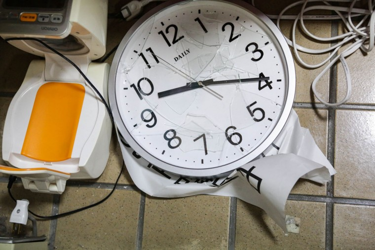 KUMAMOTO, JAPAN - APRIL 15: A clock is damaged with the time stopped after an earthquake hit near Mashiki town hall on April 15, 2016 in Kumamoto, Japan. At least nine people have died in a powerful earthquake, with a preliminary magnitude of 6.4, that struck Kumamoto Prefecture yesterday. (Photo by Taro Karibe/Getty Images)