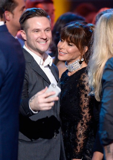 "Singer Blake Lewis and recording artist Paula Abdul celebrate onstage during FOX's ""American Idol"" Finale For The Farewell Season at Dolby Theatre on April 7, 2016 in Hollywood, California. (Photo by Kevork Djansezian/Getty Images)"