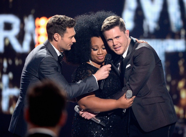 "American Idol Season 15 winner Trent Harmon (R), host Ryan Seacrest (L) and finalist La'Porsha Renae speak onstage during FOX's ""American Idol"" Finale For The Farewell Season at Dolby Theatre on April 7, 2016 in Hollywood, California. (Photo by Kevork Djansezian/Getty Images)"