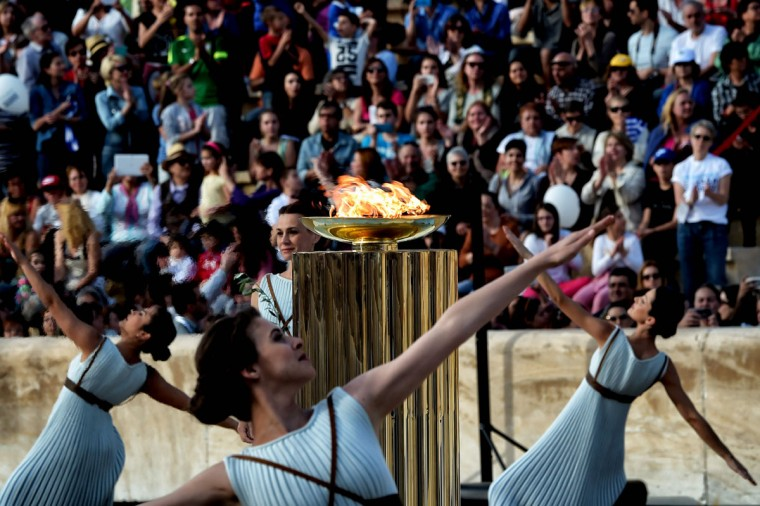 Priestesses dance around the Olympic flame burning in a cauldron, during the handover ceremony at thePanathinean stadium in Athens, on April 27, 2016. Greece on April 27 handed over to Brazilian officials the Olympic flame of the Rio Games as the 100-day countdown to the August 5 opening ceremony begins. (AFP Photo/Aris Messinis)