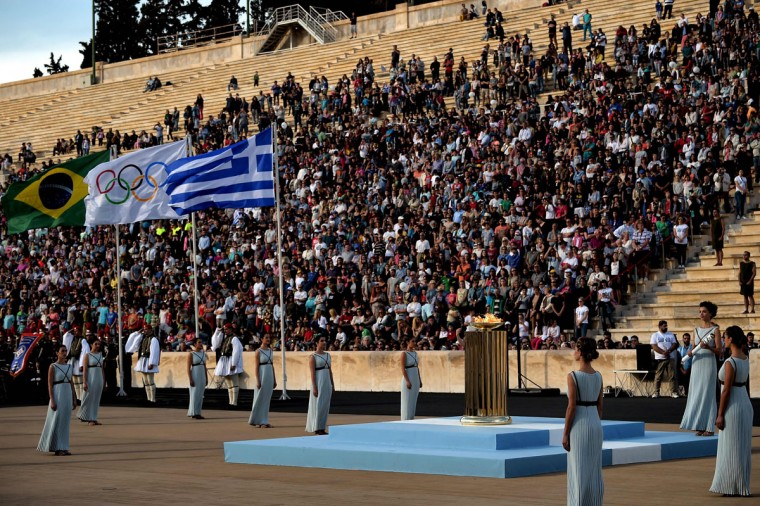 Priestesses stand next to the Olympic flame burning in a cauldron, during the handover ceremony at thePanathinean stadium in Athens, on April 27, 2016. Greece on April 27 handed over to Brazilian officials the Olympic flame of the Rio Games as the 100-day countdown to the August 5 opening ceremony begins. (AFP Photo/Aris Messinis)