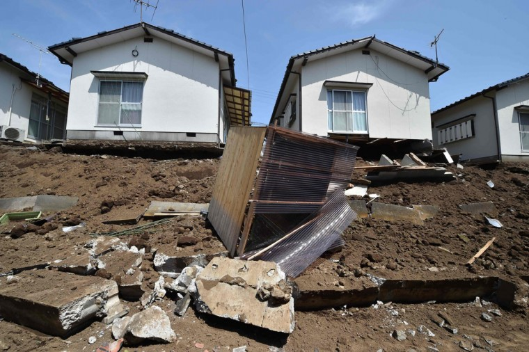 A collapsed wall is seen in the town of Mashiki, Kumamoto prefecture on April 15, 2016. A strong 6.5-magnitude earthquake hit Japan's southwestern island of Kyushu on Thursday, collapsing homes and sparking fires, officials said, but the scale of damage remained unclear. / AFP PHOTO / KAZUHIRO NOGIKAZUHIRO NOGI/AFP/Getty Images)