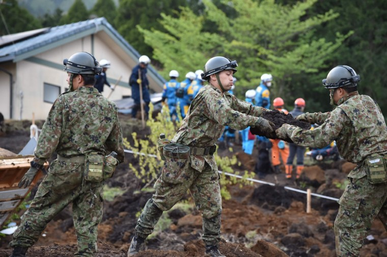 Troops of Japan's Ground Self-Defense Force search for survivors at a landslide site after earthquakes in Minami-Aso, Kumamoto prefecture, on April 17, 2016. At least 41 people are known to have died in the double disaster, with up to eight still missing -- feared buried in shattered houses or under torrents of mud. / AFP PHOTO / KAZUHIRO NOGIKAZUHIRO NOGI/AFP/Getty Images