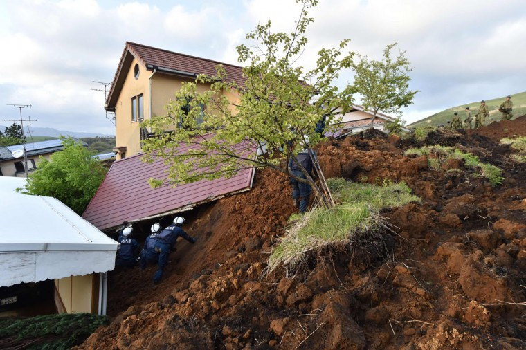 Policemen search for survivors at a landslide site after earthquakes in Minami-Aso, Kumamoto prefecture, on April 17, 2016. At least 41 people are known to have died in the double disaster, with up to eight still missing -- feared buried in shattered houses or under torrents of mud. / AFP PHOTO / KAZUHIRO NOGIKAZUHIRO NOGI/AFP/Getty Images