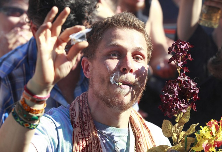 A man smokes marijuana as thousands of people gathered at 4/20 celebrations on April 20, 2016 at Sunset Beach in Vancouver, Canada. The Vancouver 4/20 event is the largest free protest festival in the city, with day-long music, public speakers and the world's only open-air public cannabis farmer's market where people sell all kinds of cannabis and extracts while educating the crowd about medical marijuana, political involvement and activism. Canadian Federal Health Minister Jane Philpott says Canada will roll out the legislation in the spring of 2017 to begin the process of legalizing and regulating marijuana. (Photo by Jeff Vinnick/Getty Images)