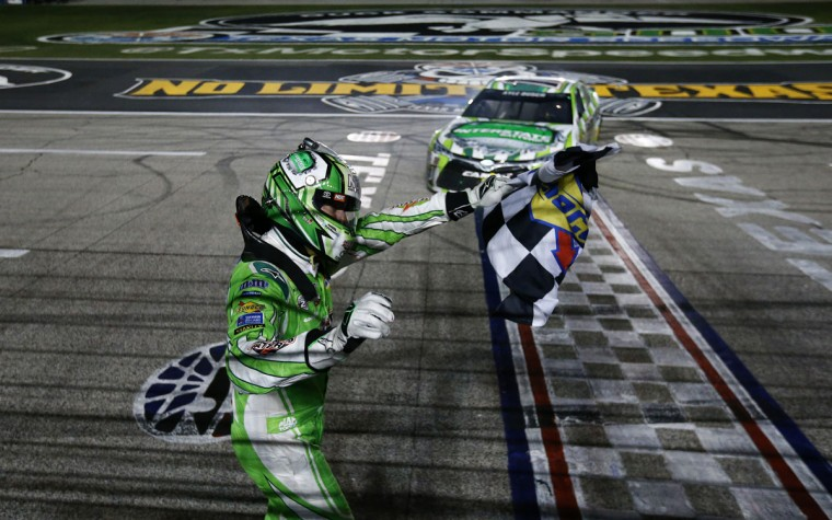 FORT WORTH, TEXAS - APRIL 09: Kyle Busch, driver of the #18 Interstate Batteries Toyota, celebrates with the checkered flag after winning the NASCAR Sprint Cup Series Duck Commander 500 at Texas Motor Speedway on April 9, 2016 in Fort Worth, Texas. (Photo by Jonathan Ferrey/Getty Images for Texas Motor Speedway)