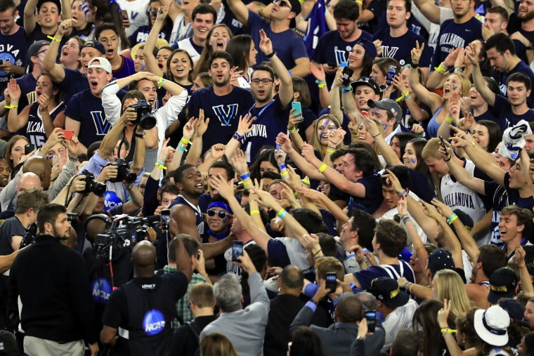 Kris Jenkins #2 of the Villanova Wildcats celebrates with fans after making the game-winning three pointer to defeat the North Carolina Tar Heels 77-74 in the 2016 NCAA Men's Final Four National Championship game at NRG Stadium on April 4, 2016 in Houston, Texas. (Photo by Scott Halleran/Getty Images)