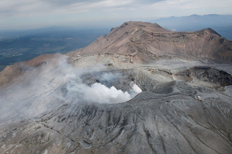 The picture shows an aerial of the largest active volcano in Japan, Mount Aso, in Aso, Kumamoto prefecture on April 16, 2016. A powerful earthquake hit southern Japan early on April 16, authorities said, sending panicked residents out of their homes in a region where nerves were already frayed by a swarm of strong shaking. / AFP PHOTO / JIJI PRESS / STR / Japan OUTSTR/AFP/Getty Images