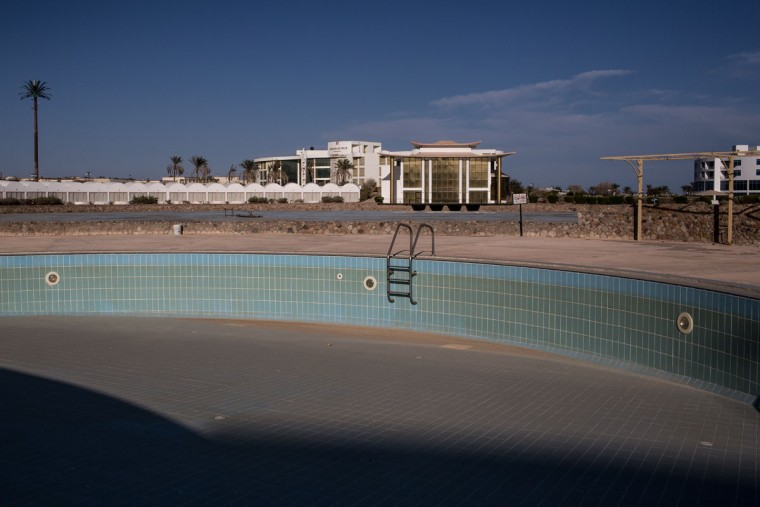 An empty swimming pool is seen at an abandoned resort on April 3, 2016 in Sharm El Sheikh, Egypt. Prior to the Arab Spring in 2011 some 15million tourists would visit Egypt each year. The resort town of Sharm El Sheikh was built around tourism however tourist numbers have plummeted after recent terrorist attacks with flights from major UK carriers being suspended and foreign offices around the world warning citizens of the 'High threat from terrorism' Sharm El Sheikh is almost a ghost town, with many resorts being abandoned and business forced to close. (Photo by Chris McGrath/Getty Images)