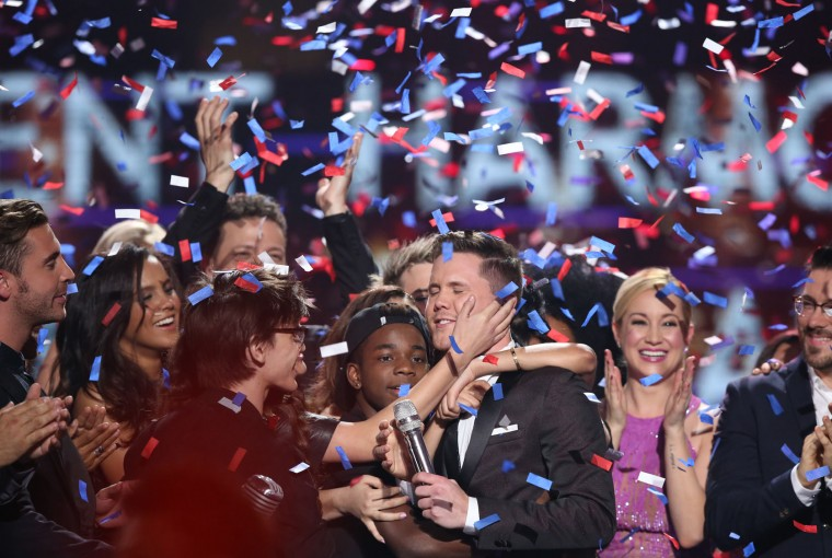 "Trent Harmon, center, winner of ""American Idol"" The Farewell Season celebrates with fellow contestants during the season finale at the Dolby Theatre on Thursday, April 7, 2016, in Los Angeles. (Photo by Matt Sayles/Invision/AP)"