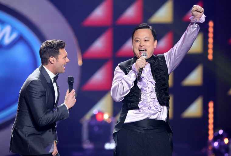 "Ryan Seacrest, left, looks on as William Hung performs at the ""American Idol"" farewell season finale at the Dolby Theatre on Thursday, April 7, 2016, in Los Angeles. (Photo by Matt Sayles/Invision/AP)"