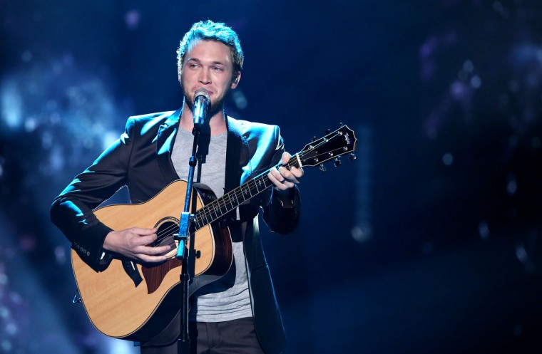 "Phillip Phillips performs at the ""American Idol"" farewell season finale at the Dolby Theatre on Thursday, April 7, 2016, in Los Angeles. (Photo by Matt Sayles/Invision/AP)"