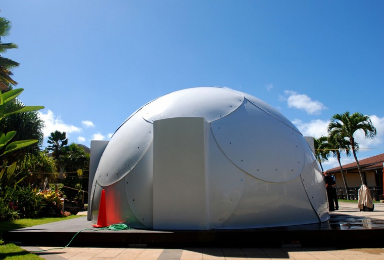 In this Friday, April 22, 2016 photo, a dome-shaped shelter is shown at the First Assembly of God church in Honolulu. The church is looking into an unexpected solution to state's homeless crisis: they're planning to erect Alaska-made igloos to house homeless families. The snow-inspired dome-shape structures would appear at first glance to be a misfit among the island state's palm trees and sandy beaches, but their bright fiberglass exterior reflects the sun, shading those inside. (AP Photo/Caleb Jones)