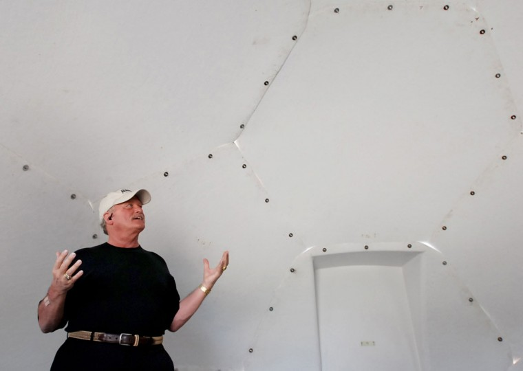 In this Friday, April 22, 2016 photo, Don Kubley, president and CEO of Juneau-based InterShelter, Inc., talks to The Associated Press inside one of his company's dome-shaped shelters at the First Assembly of God church in Honolulu. The church is looking into an unexpected solution to state's homeless crisis: they're planning to erect Alaska-made igloos to house homeless families. The snow-inspired dome-shape structures would appear at first glance to be a misfit among the island state's palm trees and sandy beaches, but their bright fiberglass exterior reflects the sun, shading those inside. (AP Photo/Caleb Jones)