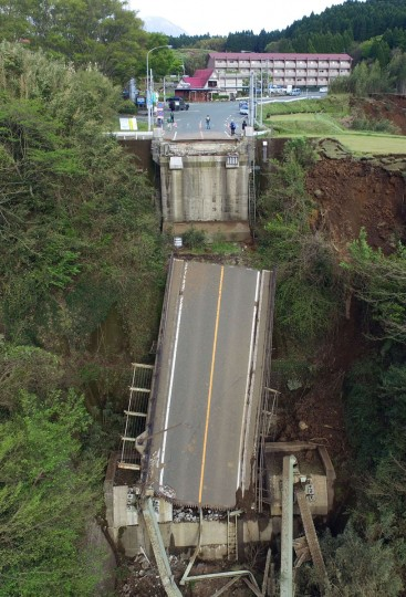 Aso Bridge is seen collapsed by a powerful earthquake in Minamiaso village, Kumamoto prefecture, Japan, Sunday, April 17, 2016. Two nights of increasingly terrifying earthquakes flattened houses and triggered major landslides in southern Japan. (Koji Harada/Kyodo News via AP)
