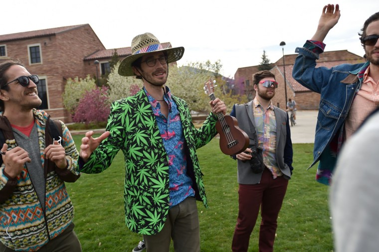 Drew Wyman talks with friends while they visited Farrand Field to see what was going on for 4/20 on the University of Colorado Boulder campus Wednesday, April 20, 2016, in Boulder, Colo. Public consumption remains illegal under the state's recreational pot law, which was passed in 2012. Fans of the drug have long marked April 20 as a day to enjoy pot — especially at 4:20 p.m. — and to call for increased legal access to it. (Autumn Parry/Daily Camera via AP)