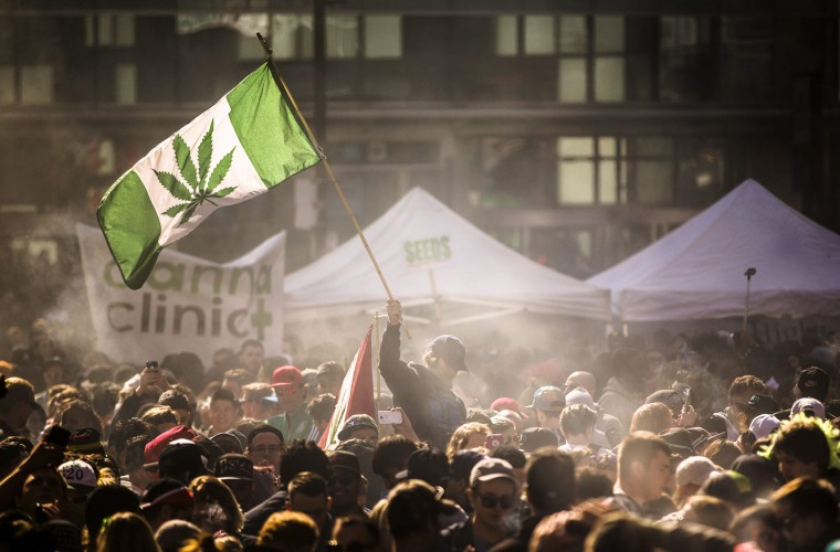 "People smoke marijuana during the ""420 Toronto"" rally in Toronto on Wednesday April 20, 2016. Cannabis possession is illegal in most countries under a 1925 treaty called the International Opium Convention. But just like the U.S., some nations either flout the treaty or don't enforce it. Legalization supporters consider pot possession either legal or tolerated in Argentina, Bangladesh, Cambodia, Canada, Chile, Colombia, the Czech Republic, India, Jamaica, Jordan, Mexico, Portugal, Spain, Uruguay, Germany and the Netherlands. (Mark Blinch/The Canadian Press via AP)"
