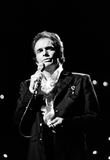 FILE - In this Oct. 8, 1977 file photo, Merle Haggard performs at the Country Music Association Awards in Nashville, Tenn. Haggard died of pneumonia, Wednesday, April 6, 2016, in Palo Cedro, Calif. He was 79. (AP Photo/Mark Humphrey, File)