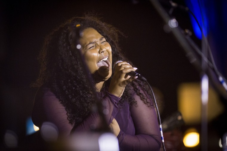 "Lizzo performs for a crowd outside of First Ave., a dance venue, to honor Prince in Minneapolis, on Thursday, April 21, 2016. Prince, widely acclaimed as one of the most inventive and influential musicians of his era with hits including ""Little Red Corvette,"" ''Let's Go Crazy"" and ""When Doves Cry,"" was found dead at his home on Thursday in suburban Minneapolis, according to his publicist. He was 57. (Renee Jones Schneider/Star Tribune via AP)"