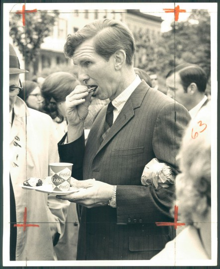 Senator Joseph Tydings enjoys crab cake at Flower Mart 1969.