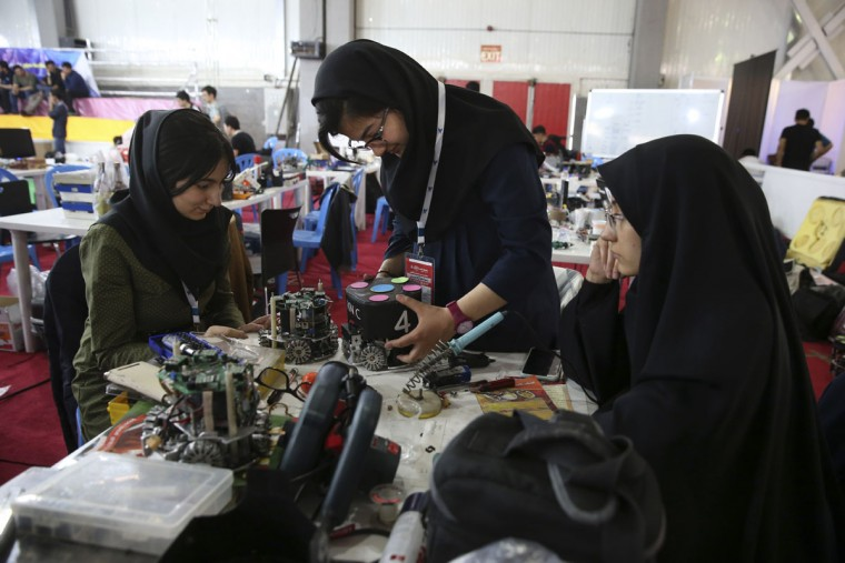 Iranian students prepare their robots during the international robotics competition, RoboCup Iran Open 2016, in Tehran, Iran, Wednesday, April 6, 2016. The event, organized by Iranian RoboCup Regional Committee and Qazvin Azad University, was participated by 320 teams from Iran and abroad. The 3-day competitions kicked off on Wednesday at Tehran's Permanent Fairground. (AP Photo/Vahid Salemi)
