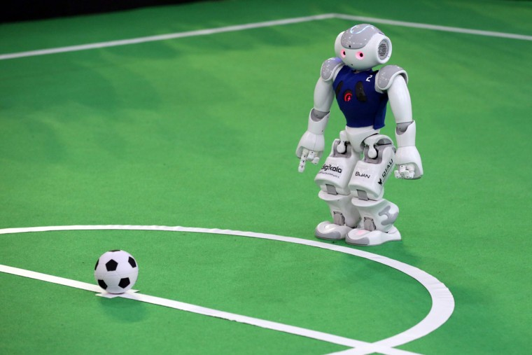 A robot from Iran's Qazvin Islamic Azad University takes part in a soccer match against Germany's Nao-Team HTWK of Leipzig United University during the RoboCup Iran Open 2016, in Tehran on April 6, 2016. (ATTA KENARE/AFP/Getty Images)