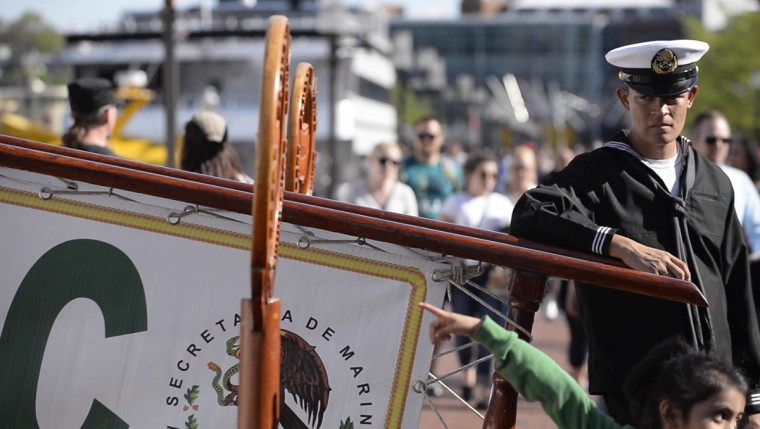 A marinero stands watch at the gangplank boarding the training ship Cuauhtemoc. (Christina Tkacik/Baltimore Sun)