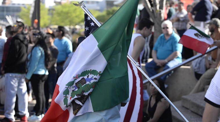 Observers carried Mexican flags at Baltimore's Inner Harbor. Among the crowds were Mexican-American families who brought their children to watch the ship arrive in Baltimore. (Christina Tkacik/Baltimore Sun)