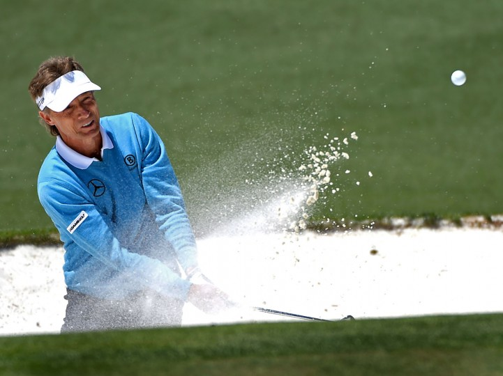 Bernhard Langer hits from a sand trap along the 2nd green during the third round of the 80th Masters at the Augusta National Golf Club in Augusta, Ga., on Saturday, April 9, 2016. (Jeff Siner/Charlotte Observer/TNS)