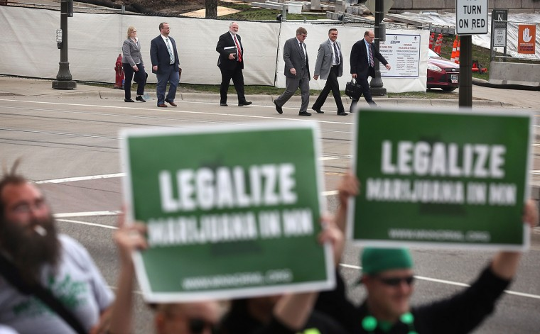People in business attire left the State Capitol as the protest took place at a church across the street on April 20, 2016 in St. Paul, Minn. A rally held at the State Capitol and also at a nearby church, Minnesota Stands Together Against Cannabis Prohibition, involved several of Minnesota's pro-cannabis groups who marched and rallied to end cannabis prohibition in Minnesota. (Jim Gerz/Minneapolis Star Tribune/TNS)