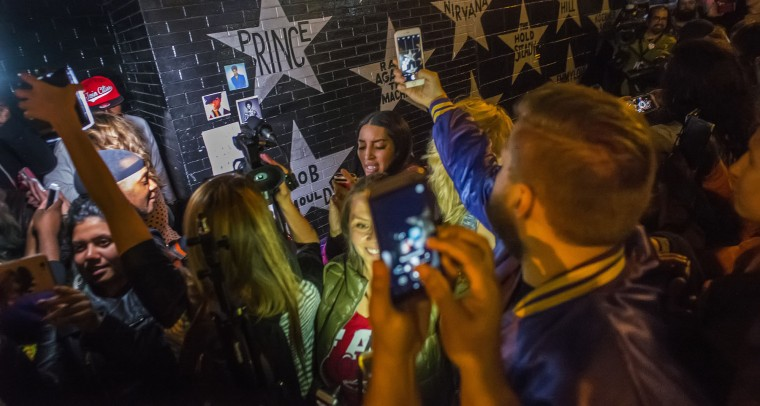 "At First Ave where ""Purple Rain"" was filmed, fans of Prince paid tribute to the pop icon who passed away on April 21, 2016 in Minneapolis, Minn. Prince was 57. (Richard Tsong-Taatarii/Minneapolis Star Tribune/TNS)"
