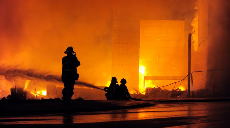 Firefighters work a blaze Federal and Gay streets in East Baltimore, which consumed senior housing and a community center under construction. (Lloyd Fox/Baltimore Sun)