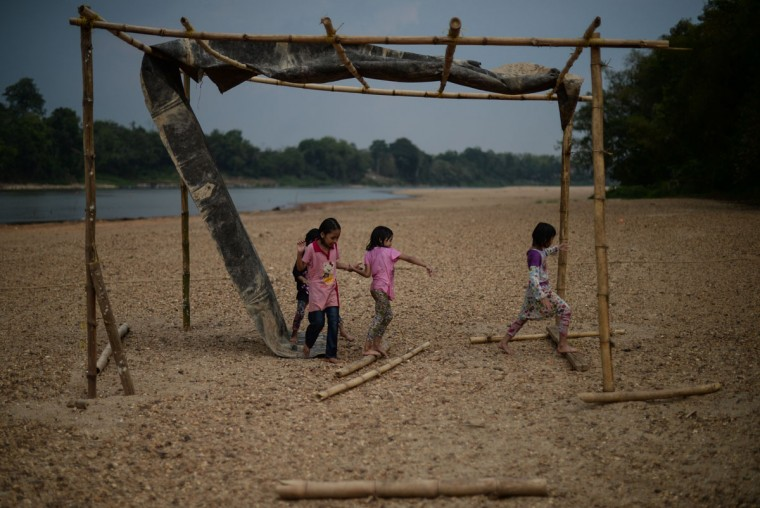Children play along the dry banks of the Pahang river as schools remain closed due to the ongoing heatwave in Termerloh, outside Kuala Lumpur, on April 11, 2016. (MOHD RASFAN/AFP/Getty Images)