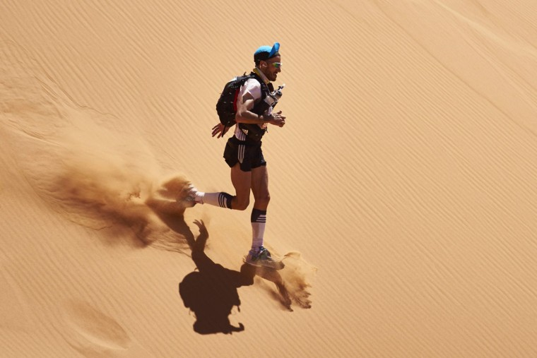 A competitor takes part in the second stage of the 31st edition of the Marathon des Sables on April 11, 2016 in the southern Moroccan Sahara desert. (JEAN-PHILIPPE KSIAZEK/AFP/Getty Images)