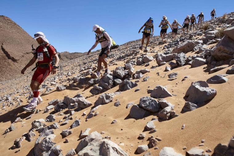 Competitors take part in Stage 3 of the 31st edition of the Marathon des Sables between Oued Moungarf and Ba Hallou in the southern Moroccan Sahara desert on April 12, 2016. (JEAN-PHILIPPE KSIAZEK/AFP/Getty Images)