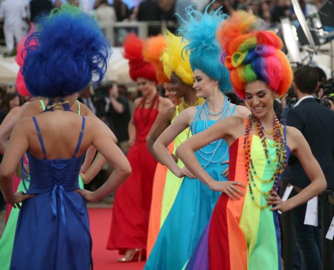 Models walk on the red carpet, during a photo call for the film Trolls at the 69th international film festival, Cannes, southern France, Wednesday, May 11, 2016. (AP Photo/Joel Ryan)