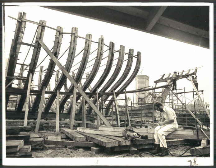 "Construction of the Pride of Baltimore. Hand-built from wood, the schooner was originally meant to be a museum piece, docked in the harbor. It later set sail as a ""goodwill ambassador"" and traveled the world representing the city of Baltimore. On May 14, 1986, the ship was caught in a storm and sank off the coast of Puerto Rico. 4 crew members died."
