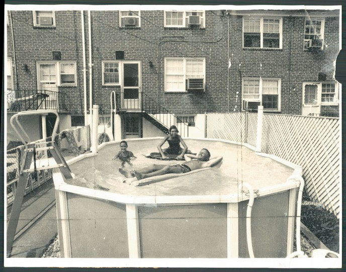 July 22, 1980. Lisa and Mike Jerscherd relax and beat the heat in their pool on East Gittings avenue with their guest Rody Barthelmes.
