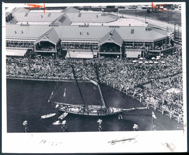 July 3, 1980-The Pride of Baltimore arrives in the Inner Harbor to take part in the festivities at the opening of Harborplace as thousands line the shore and jam the pavilions. Photo by Sun photographer J. Pat Carter.