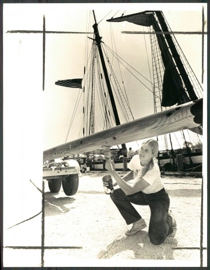 "A crew member repairing the Pride of Baltimore in 1981, five years before the ship sank in a storm. The caption read, ""The Pride of Baltimore, the city's publicity clipper ship, undergoes repairs in St. Michael's after being damaged in a storm off the Florida Keys."""