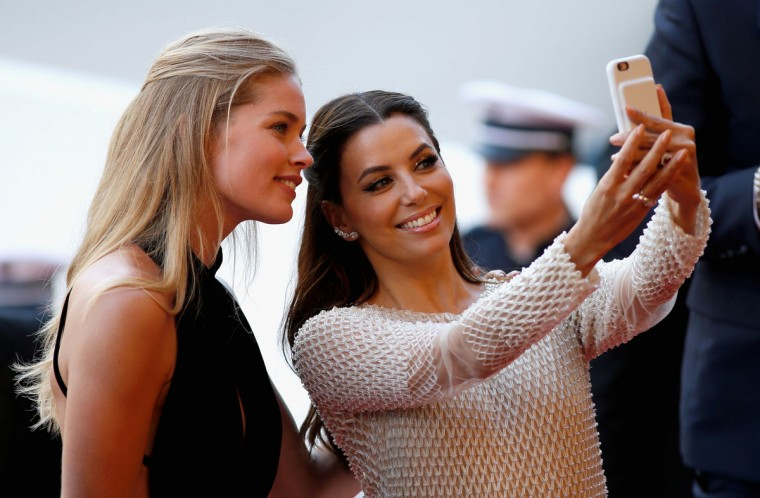 """CANNES, FRANCE - MAY 11: Model Doutzen Kroes and american actress Eva Longoria attend the """"Cafe Society"""" premiere and the Opening Night Gala during the 69th annual Cannes Film Festival at the Palais des Festivals on May 11, 2016 in Cannes, France. (Photo by Tristan Fewings/Getty Images)"""