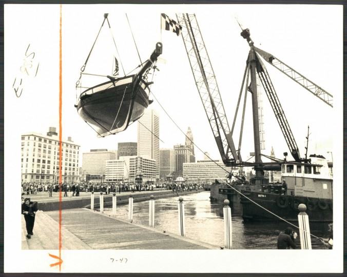 Photo of the Pride of Baltimore being christened and lowered into the Inner Harbor. The ship was a replica of the famed sleek Baltimore clippers and was a roving goodwill ambassador for the city until it sank in a storm on May 14, 2016.