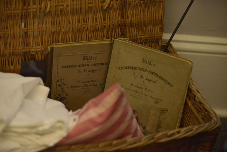 An exhibit at the Baltimore Immigration Museum in Locust Point shows what kinds of items an immigrant might take from Europe to the United States -- books and bedding, for example. (Christina Tkacik/Baltimore Sun)