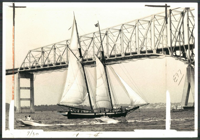 June 23, 1977-BREEZE-FILLED TOPSAIL--The Pride of Baltimore sails toward the Francis Scott Key Bridge on its way home. Photo by Sun photographer Lloyd Pearson.