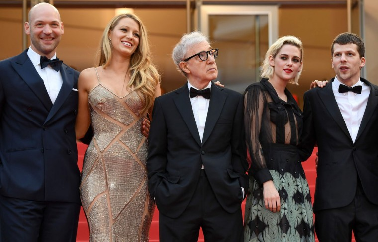 """US director Woody Allen (C) poses with (fromL) US actor Corey Stoll, US actress Blake Lively, US actress Kristen Stewart and US actor Jesse Eisenberg as they arrive on May 11, 2016 for the screening of the film """"Cafe Society"""" during the opening ceremony of the 69th Cannes Film Festival in Cannes, southern France. / AFP PHOTO / ANNE-CHRISTINE POUJOULATANNE-CHRISTINE POUJOULAT/AFP/Getty Images"""