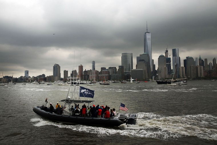 A spectator boat moves by the activity in New York Harbor as America's Cup racing begins two days of sailboat racing on May 07, 2016 in New York, New York. The six teams will compete for points that count toward the final competition, to be held next year in Bermuda. Sailing on catamarans just off-shore of lower Manhattan, it is being called the biggest sailing event on the Hudson River in nearly a century. (Photo by Spencer Platt/Getty Images)