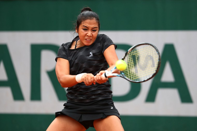 Zarina Diyas of Kazakhstan plays a backhand during the Women's Singles first round match against Carina Witthoeft of Germany on day two of the 2016 French Open at Roland Garros on May 23, 2016 in Paris, France. (Photo by Julian Finney/Getty Images)